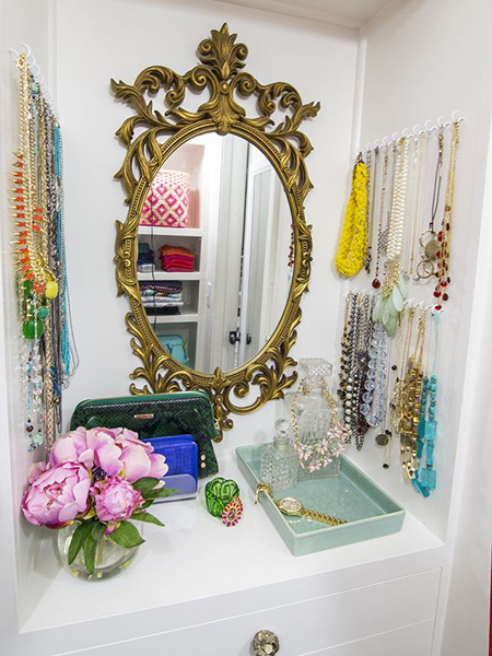 Haven't you heard? Jewelry is art! Use your bolder necklaces as room decor by hanging them from hooks around a chic mirror or picture. Find this idea on Pinterest.