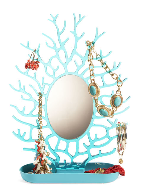 Dress up decorative pieces around your room even more by adding a touch of jewelry here and there.