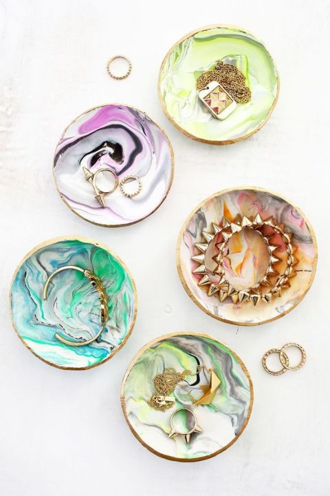 Pick up vintage or inexpensive little dishes at a second hand store or on Etsy, and fill them with rings and earrings. Find this idea on Pinterest.