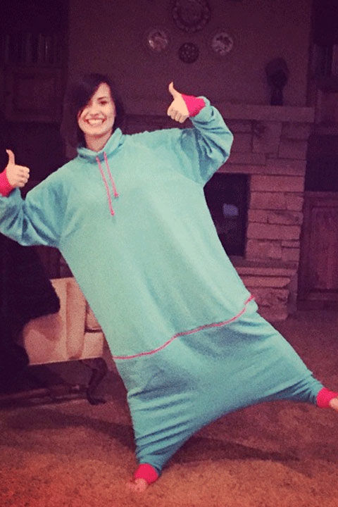 "We give Demi a thumbs up for rocking the ""pod,"" basically a onesie without the legs. She captioned her hilariously adorbs Insta pic: ""Onesies are so 2014. Cozy pods are where it's at..."""