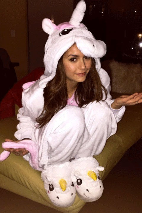 The former Vampire Diaries star looks warm and whimsical in her pastel pink unicorn onesie.