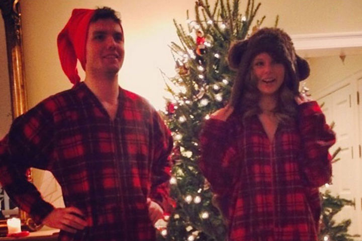 Of course, T. Swift and her little bro Austin celebrate Christmas in matching red plaid onesies. Cuties!