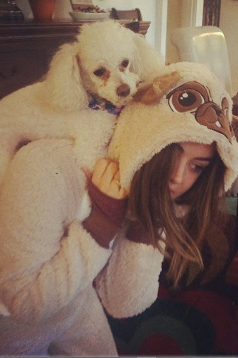 "Twinning! The PLL star matches her pooch in this fluffy onesie. She captioned her Insta pic, ""Jacks got my back."" Lolz."