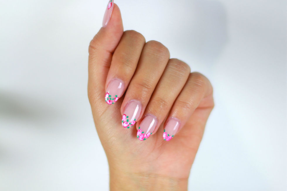 Bored with your basic French mani and feeling ready to switch things up? Instead of painting your tips with a simple white line, add flowers for the perfect pop of spring! To execute this look flawlessly, first polish your nails in a neutral shade. Once they're dry, use a nail art brush to create 2-3 blobs on each nail. Next, swirl a lighter shade into the blobs and a few random green dots  to achieve those swirly flowers we're after. Finish with a shiny top coat and you're good to go!