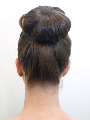 Groovy Secret Trick To Doing The Donut Bun How To Style A Donut Bun Hairstyles For Women Draintrainus